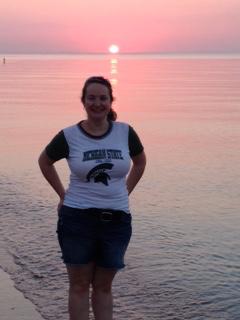Joanne Philhower at beach in MSU attire