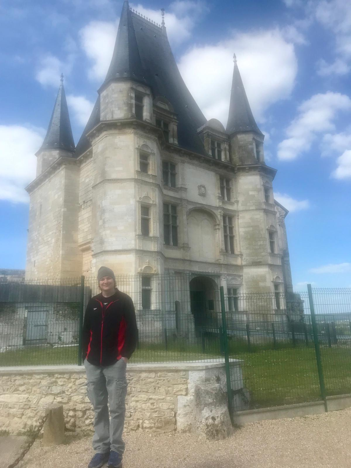 David in front of a castle he would like to purchase