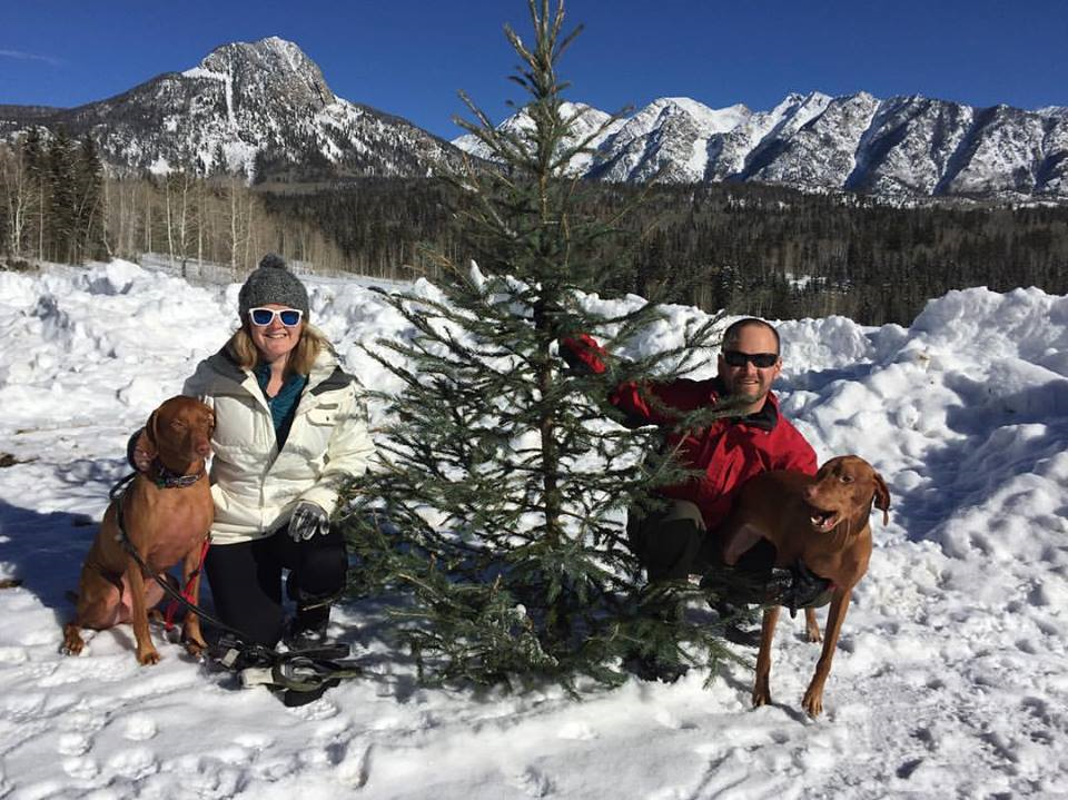 Chuck and Hannah in snow with dogs